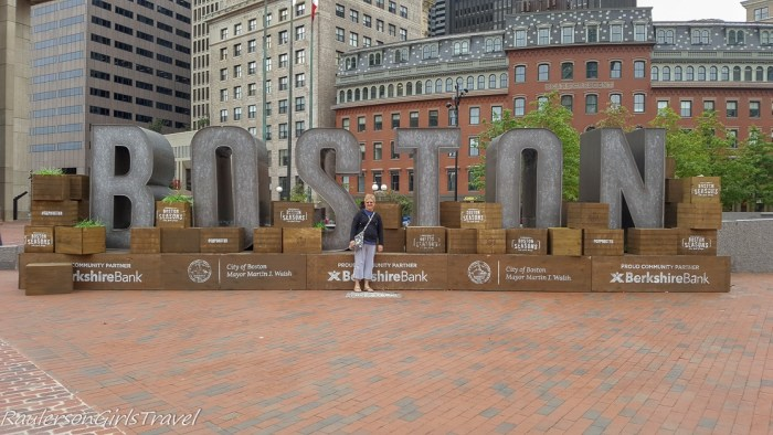 Loraine in front of Boston sign