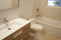 Remodeled bathrooms with matching Vanities & Porcelain Tile