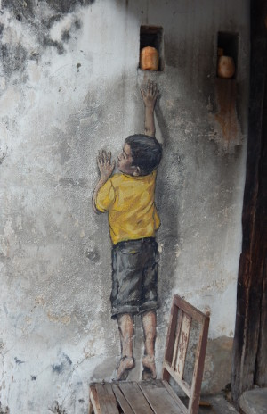 Boy on Chair von Zacharevic, Street Art Penang