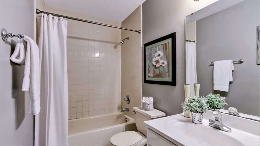 One of our favorite tips for staging a home is to always leave shower curtains open!