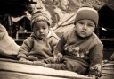 Chitkul babies, wondering what the camera is. Chitkul, Himalayas.