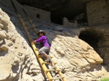 Climbing into the cliff dwellings