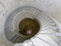 Looking down the circular staircase inside the lighthouse