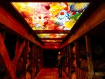 Barrel aging room with Chihuly glass ceiling