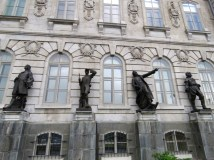Explorers, missionaries, and military figures adorn the Parliament Building