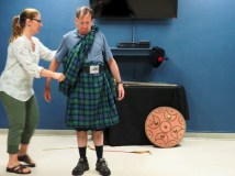 Demonstrating how to dress in a kilt