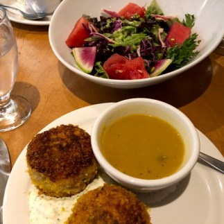 Crabcakes, butternut squash soup, and a watermelon and radish salad