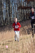 9 Year Old Christopher Demuth on Pell Hill followed by his dad Chris (photo by Tom Casper)