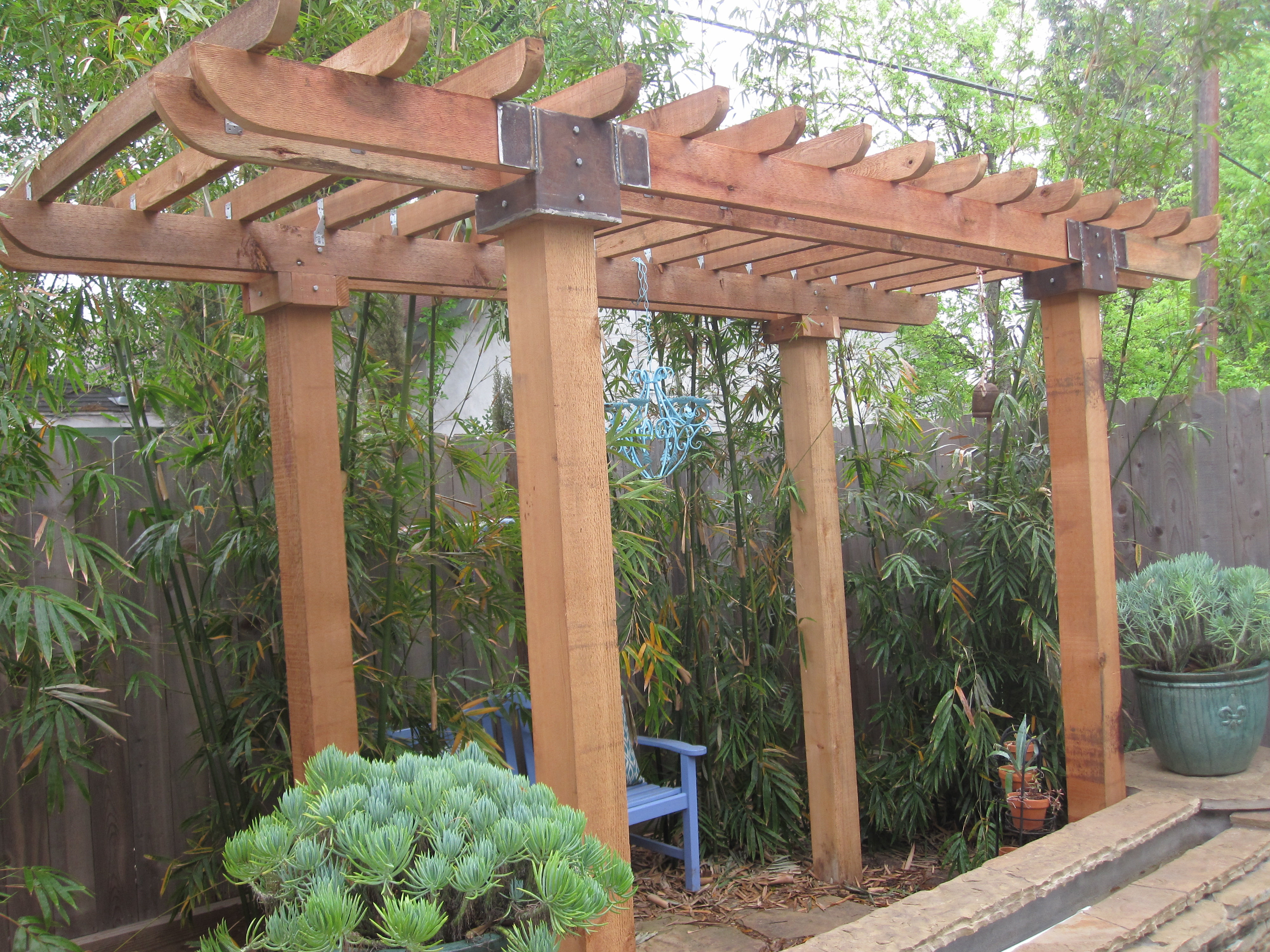 Landscaping  Pergola at the end of a Pool
