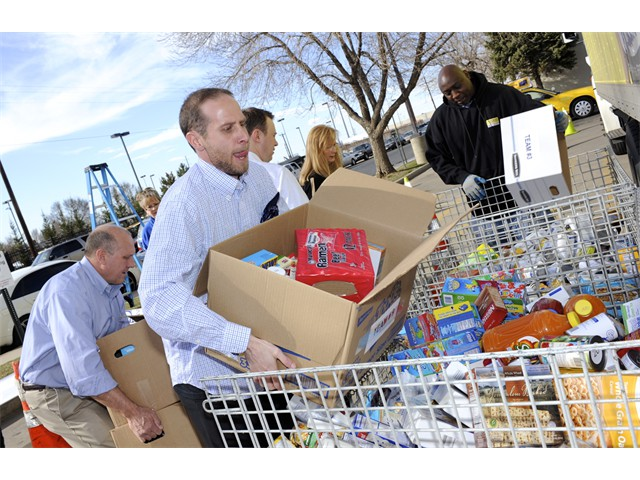Hole-In-One for Hunger - Taking the Food to the Food Bank Bins