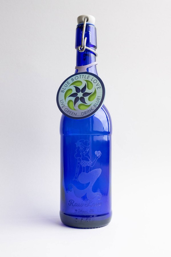 tall blue glass water bottle