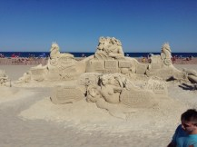 sea side, purple urchin, Mc Donalds, Hampton Beach, NH, sand sculptures, sand art, art, castles, beach, fun, adventure, travel, journey, authorblog, blogseries, writer, author, booknerd, nerd, books, fantasy, mustread, storytelling, blue, white, high-five, waves, ocean, sea, story, blogger, book blog, dream,