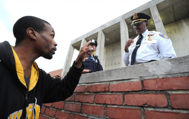 Baltimore,MD-4/20/15 -- Travis Robertson of Baltimore has a few words with Lt. Col. Melvin Russell outside of the Western District Police Station. Protest outside of the Western District Police Station after Freddie Gray died while in police custody. Lloyd Fox/Baltimore Sun #5553