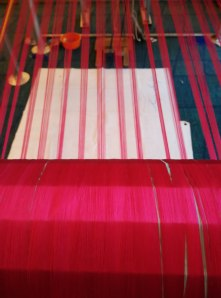 Pink silk thread on the loom
