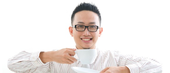 chinese business man having coffee