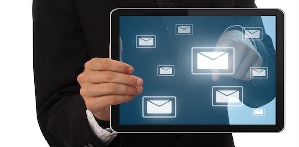 Businessman pressing e-mail buton