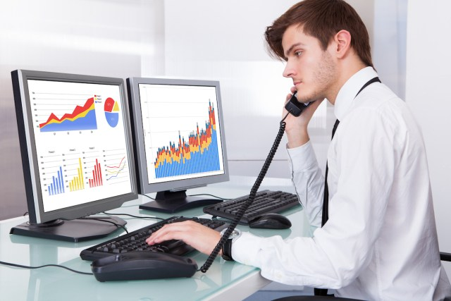 Stock Broker Working At Office