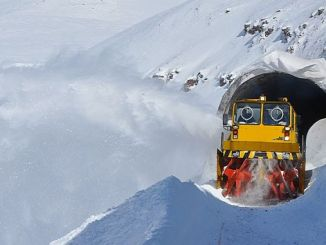 railroad workers clean snow and ice in order to avoid disruption
