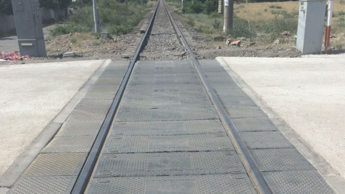 as a result of the tender of the level crossing with rubber coating