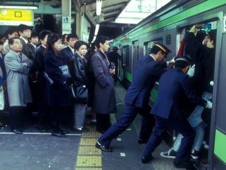 train pushers in japan subway at work
