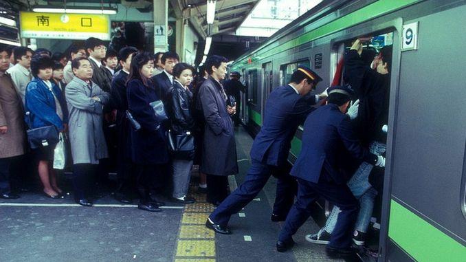 train pushers in japan subway at work