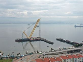 seka pier is being washed with a floating crane