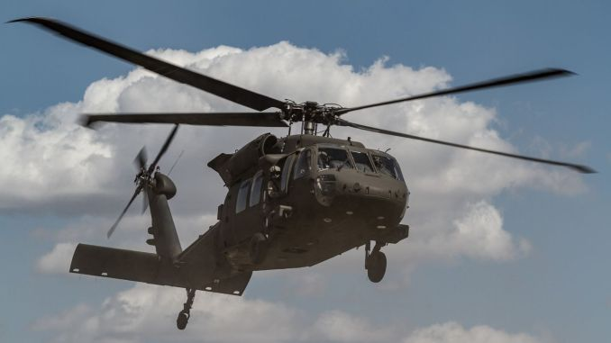 black hawk helicopter dropping carrying the national guards in us