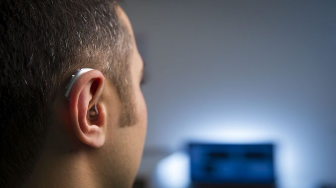 hearing implants eliminated disability