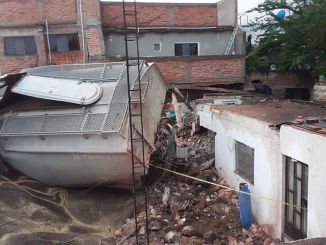 Derailed train in Mexico damaged house