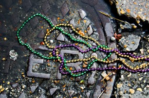 Manhole cover and Mardi Gras beads.