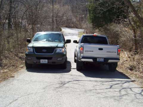 GOING_SOUTH_ON_BENNINGTON_3_1-2_FT_DITCHES_ON_EACH_SIDE_THE_VEHICLES_ARE_STOPPED_ON_ROAD_NOT_DRIVING_BY_EACH_OTHER_TOO_CLOSE_TO_TRY_THAT