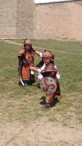 Kids dressed as Mongolian warriors outside the monastery