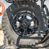 Inside bed view of Polaris General Spare Tire Mount Shown on rack