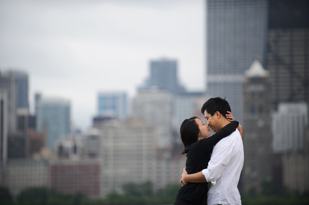 the couple against the chicago skyline as seen from lincoln park