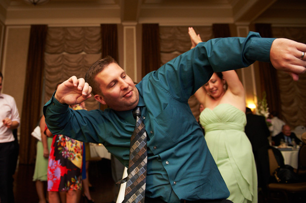 wedding guest showing off his dancing moves