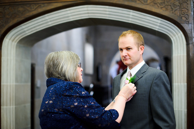 mother of the groom adjusting the boutonniere