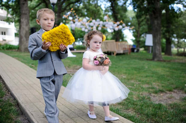 Ring bearer and the flower girl walking down the isle