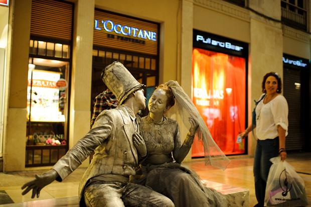 street performers raising money for their wedding