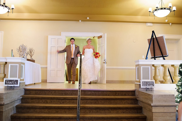 Bride and groom entering the reception venue