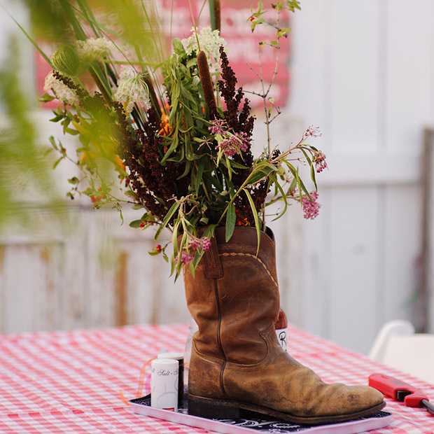Flowers were set on tables using texan boots as vases