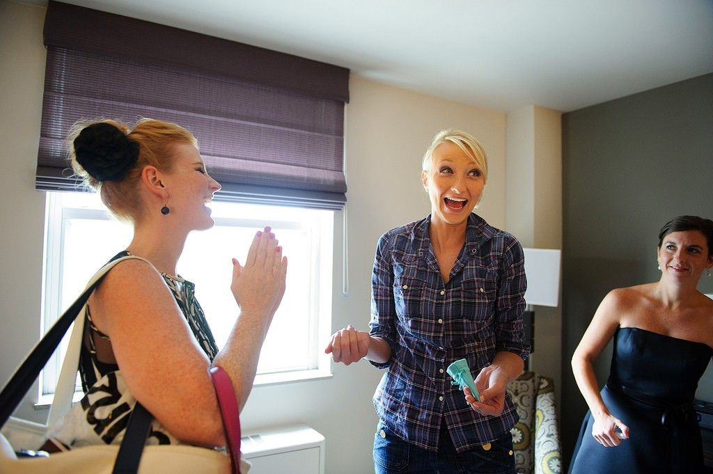 bride with bridesmaids getting ready for the wedding - photo by Iowa City wedding photographer razvan