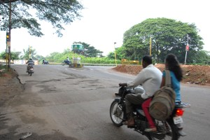 Helmet less driving on a potholed road in Mysore