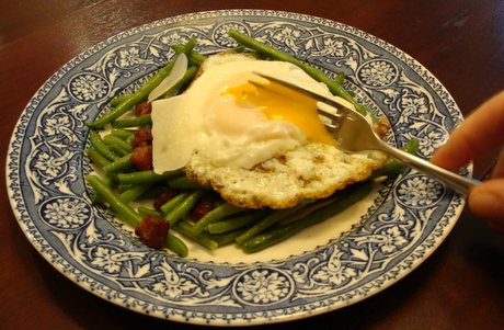 fried egg on vegetables and salads