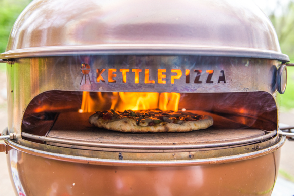 The KettlePizza Kit turns your grill into a wood burning oven.
