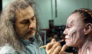 Michael Spatola appying RBFX prosthetics on Jojo Zhu