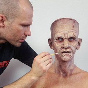 Sidney Cumbie appying RBFX prosthetics on Gordon Tarplay