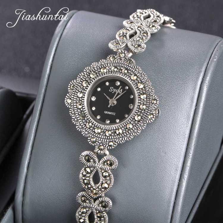 серебряные часы на ювелирном браслете