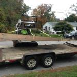 Lifting ramp off of trailer