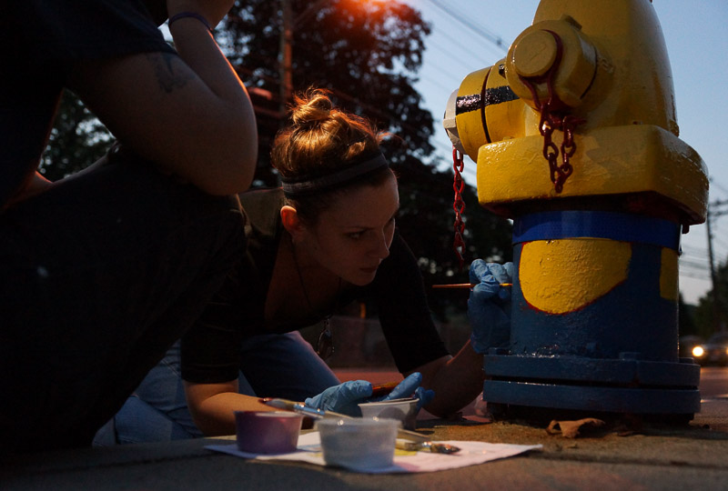 Sarah painting a fire hydrant in Greeneville CT