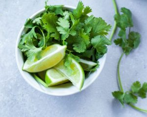 Bowl filled with Cilantro and Limes